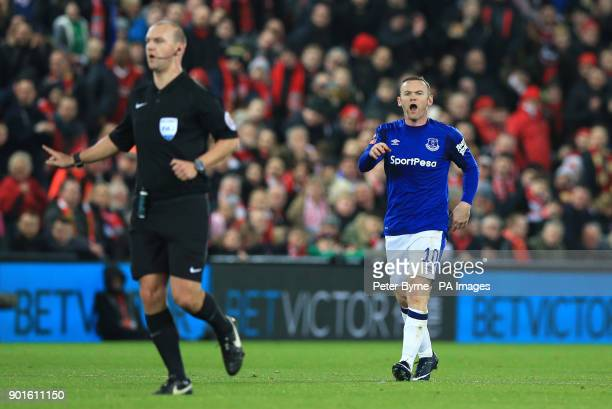 Everton's Wayne Rooney shouts at referee Bobby Madley during the FA Cup third round match at Anfield Liverpool