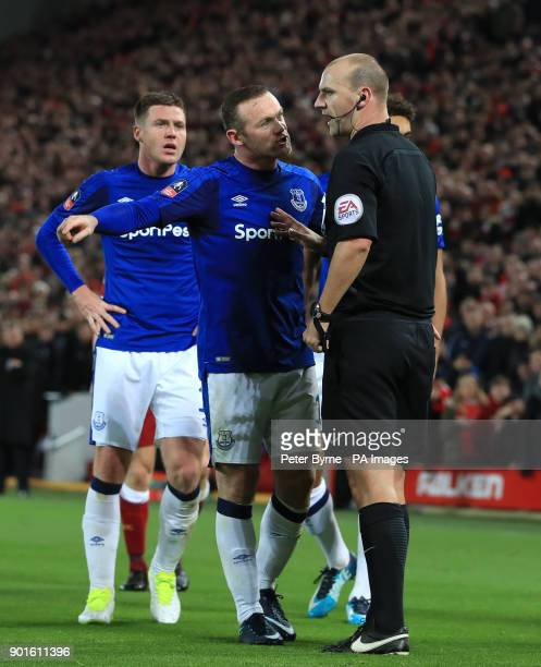 Everton's Wayne Rooney speaks to referee Bobby Madley during the FA Cup third round match at Anfield Liverpool