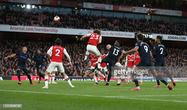 Everton's Yerry Mina heads towards Richarlison for him to score his sides second goal during the Premier League match between Arsenal FC and Everton...