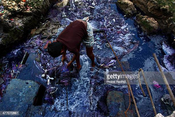 GAZIPUR DHAKA BNAGLADESH GAZIPUR BANGLADESH Every day 9 year old Jashim collects pieces of cloth from the liquid waste of the dyeing industries He...