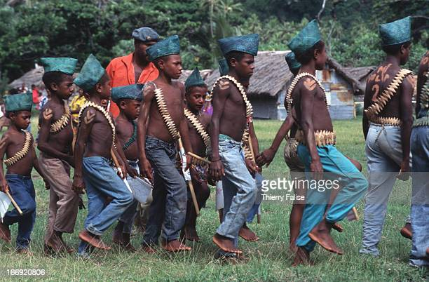 Every February 15th followers of John Frum a cargo cult leader organize a big celebration in Sulphur Bay a village along the Pacific Ocean on the...
