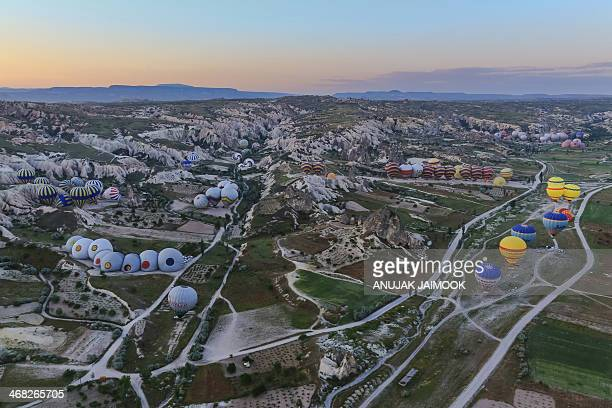 CONTENT] Every morning the hundred hot air balloons will take tourist over Cappadocia area It take approximately 1 hours for the tour Cappadocia is a...