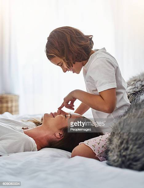 every mother's treasure is her daughter - brown hair stock pictures, royalty-free photos & images