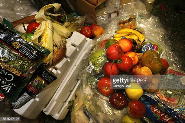 YORK – Every night large quanities of food is thrown away by markets all over New York such as these items found during Freegan Trash tour The...