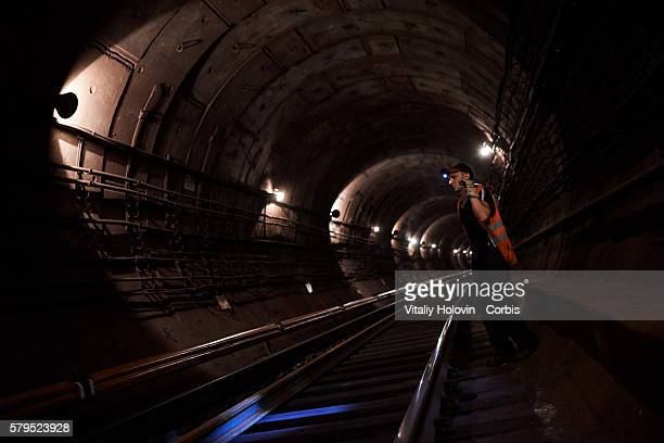 Every night, when trains stop running on the subway workers replace almost 1 km of damaged rails in the underground tunnels on July 21, 2016 in Kiev,...
