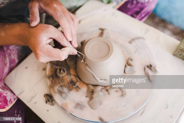 every piece she makes is unique! - ceramics stock pictures, royalty-free photos & images