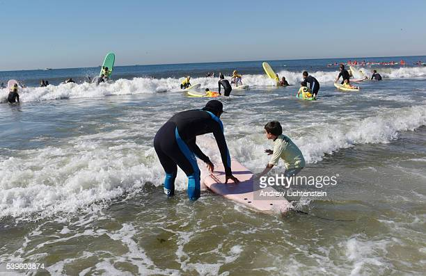 Every summer professional surfers teach children how to surf at a summer surf camp in Long Beach New York