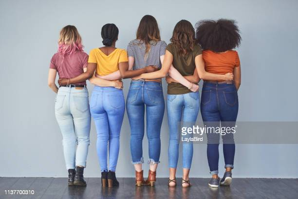 every woman needs another woman who's got her back - jeans stock pictures, royalty-free photos & images