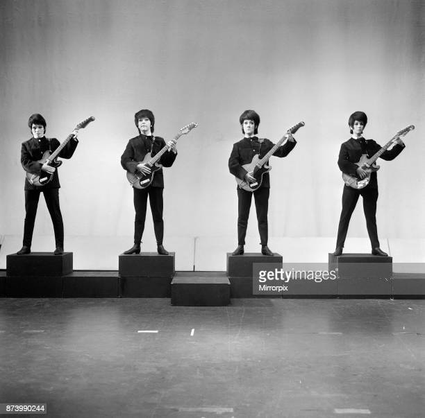 Everybody wants to get into the act Even girls The four Beatlebrowed birds in the picture are takingoff the top pop group for a new show Their...
