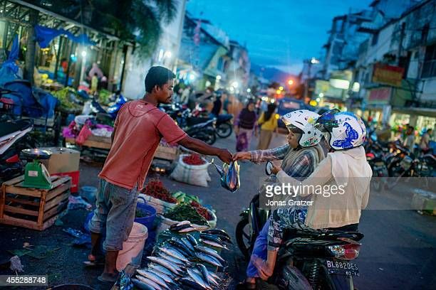 Everyday life at an open air market in downtown Banda Aceh The tsunami of December 2004 was as deadly as the atomic bombs that were dropped on...