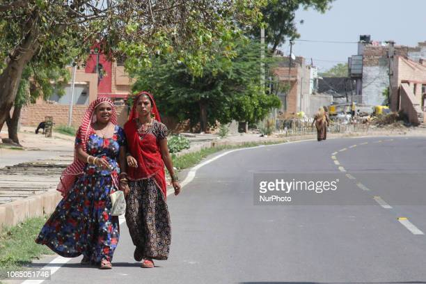 Everyday life images of women in the city of Jodphur in Rajasthan India Women in India especially in Rajasthan are typically used to wear traditional...