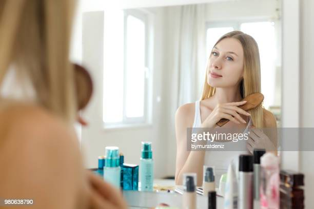 everyday routine for every woman! - mirror stock photos and pictures
