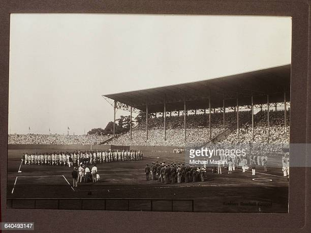 Everyone - baseball players, marching band and spectators - seems to be standing at attention before or after a baseball game at Koshien Kyujo...