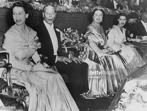 Everyone in the Royal Box at the Royal Command film performance in London seems to be having a good time Smiling cheerfully are Princess Elizabeth...