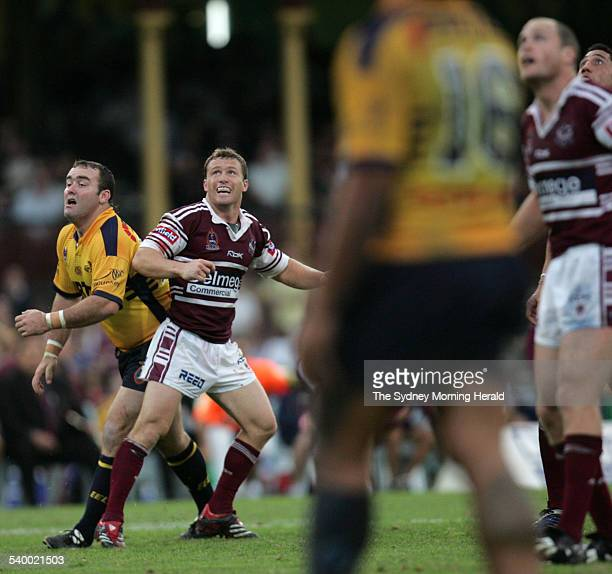 Everyone looks toward the posts as Manly's Matt Orford kicks the winning field goal during the Round 8 NRL rugby league match between the Manly Sea...