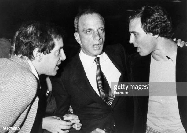 Everyone seems to be talking simultaneously in this picture made early at Studio 54 Flanking attorney Roy Cohn are his two clients coowners of Studio...