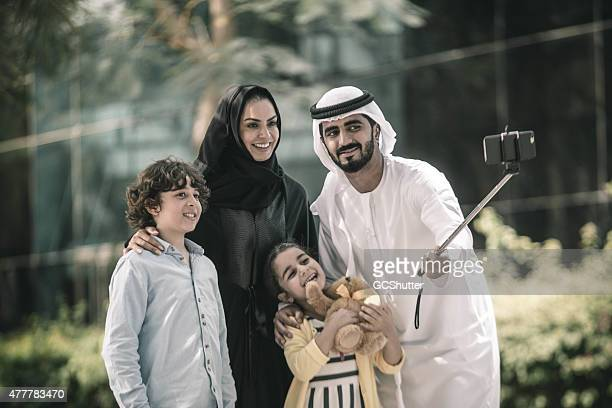 Everyone Smile, Selfie time. A modern Arab family in park