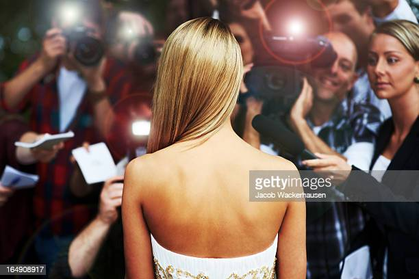 everyone wants a piece of her - celebrity lifestyle - actress stock pictures, royalty-free photos & images