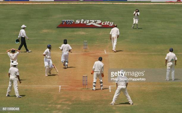 Everyone watches in anticipation as England's Monty Panesar gets set to catch the chance from India's Mahendra Singh Dhoni off the bowling of Shaun...
