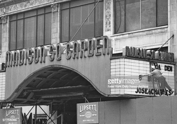 Everything in Madison Square Garden must go and the workmen reach up to pluck a letter from marquee of the old Madison Square Garden at Eighth Ave...