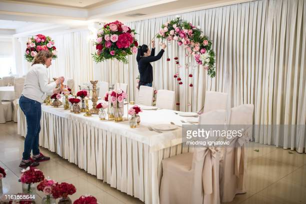 everything is almost finished for wedding ceremony - banquet hall stock pictures, royalty-free photos & images
