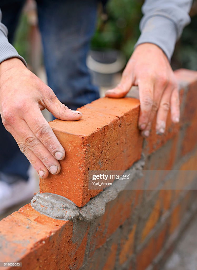 Everything is built one brick at a time : Stock Photo