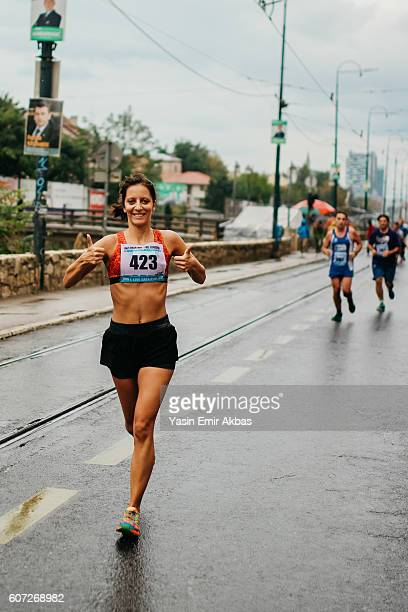 everything is okay for this lady runner - half_marathon stock pictures, royalty-free photos & images