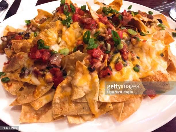 everything nachos - nachos stock photos and pictures
