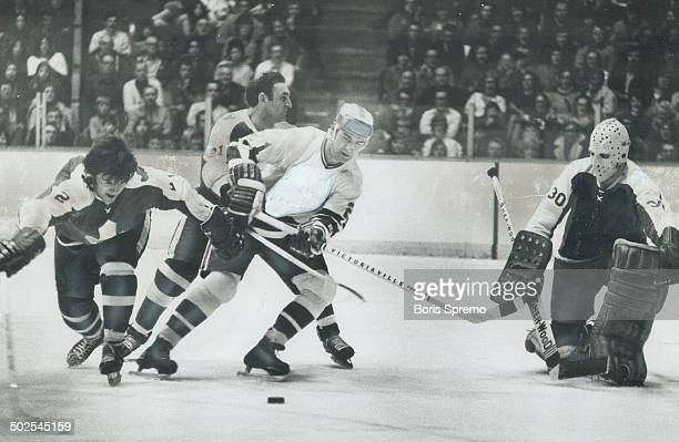 Everything under control While Toronto defenceman Rick Ley stretches to reach sliding puck his fellow rearguard Bob Baun takes care that Dave Balon...