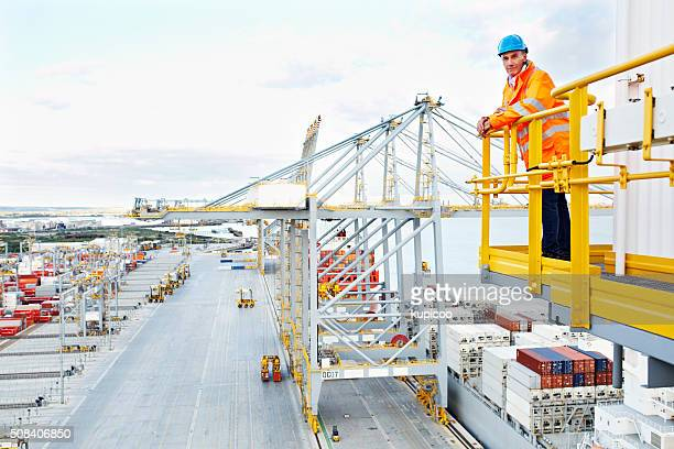 everything's going according to schedule - dock worker stock photos and pictures