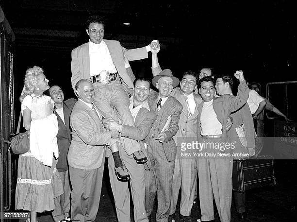 Everything's Jake Now Jake LaMotta's still wearing world championship middleweight belt as admirers hoist him on shoulders upon arrival yesterday at...