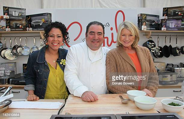 Evette Rios Emeril Lagasse and Martha Stewart pose together after Emeril Lagasse Launches New HighPerformance Kitchen Collection At JCPENNEY at...