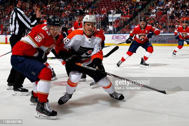 Evgeni Dadonov of the Florida Panthers crosses sticks with Morgan Frost of the Philadelphia Flyers at the BBT Center on November 19 2019 in Sunrise...