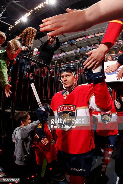 Evgeni Dadonov of the Florida Panthers heads out to the ice for warm ups prior to the start of the game against the Detroit Red Wings at the BBT...