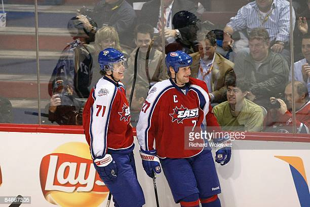 Evgeni Malkin and Alexei Kovalev of the Eastern Conference AllStars look to celebrate after a play during the 2009 NHL AllStar game at the Bell...