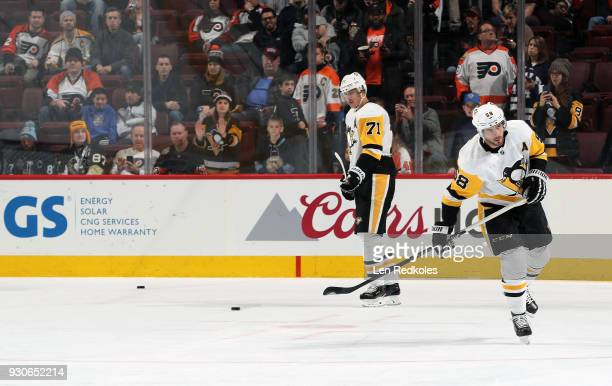 Evgeni Malkin and Kris Letang of the Pittsburgh Penguins warm up against the Philadelphia Flyers on March 7 2018 at the Wells Fargo Center in...