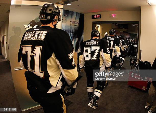 Evgeni Malkin and Sidney Crosby of the Pittsburgh Penguins leave the locker room prior to the game against the New York Islanders on November 21 2011...