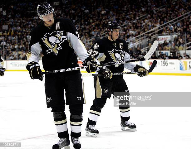 Evgeni Malkin and Sidney Crosby of the Pittsburgh Penguins line up for a faceoff against the Atlanta Thrashers at Consol Energy Center on December 28...