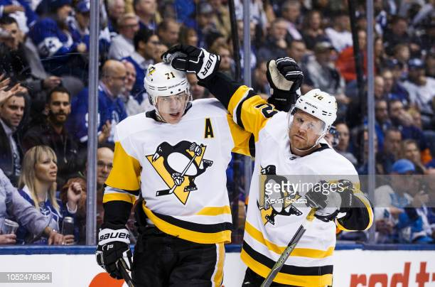 Evgeni Malkin celebrates his goal with Patric Hornqvist of the Pittsburgh Penguins during the first period against the Toronto Maple Leafs at the...