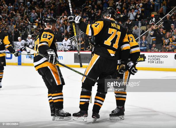 Evgeni Malkin celebrates his goal with Sidney Crosby of the Pittsburgh Penguins during the third period against the Los Angeles Kings at PPG Paints...