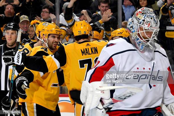 Evgeni Malkin celebrates with Sidney Crosby and Phil Kessel and Justin Schultz of the Pittsburgh Penguins after recording his 1000 NHL point against...