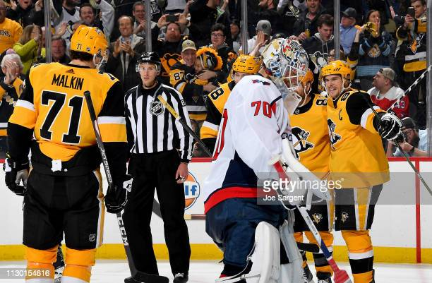 Evgeni Malkin celebrates with Sidney Crosby and Phil Kessel of the Pittsburgh Penguins after recording his 1000 NHL point against the Washington...