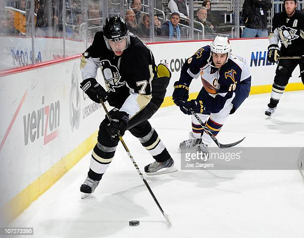 Evgeni Malkin of Pittsburgh Penguins moves the puck in front of the defense of Andrew Ladd of the Atlanta Thrashers on December 2 2010 at Consol...