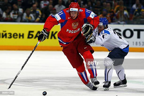 Evgeni Malkin of Russia is challenged by Sami Kapanen of Finland during the IIHF World Championship qualification round match between Russia and...