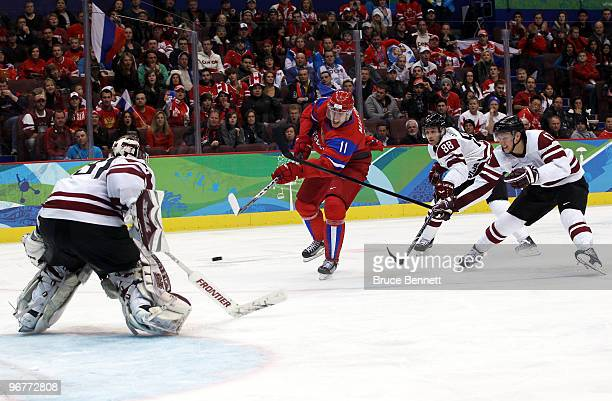 Evgeni Malkin of Russia takes a shot on goal during the ice hockey men's preliminary game between Russia and Latvia on day 5 of the Vancouver 2010...
