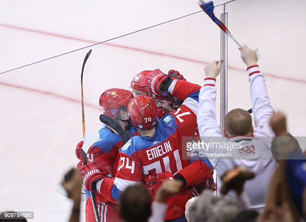 Evgeni Malkin of Team Russia is congratulated by teammates on his third period goal against Team Finland during the World Cup of Hockey tournament at...