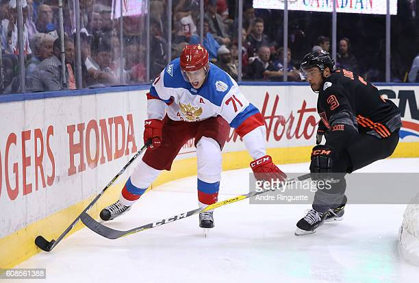 Evgeni Malkin of Team Russia pulls the puck away from Seth Jones of Team North America during the World Cup of Hockey 2016 at Air Canada Centre on...