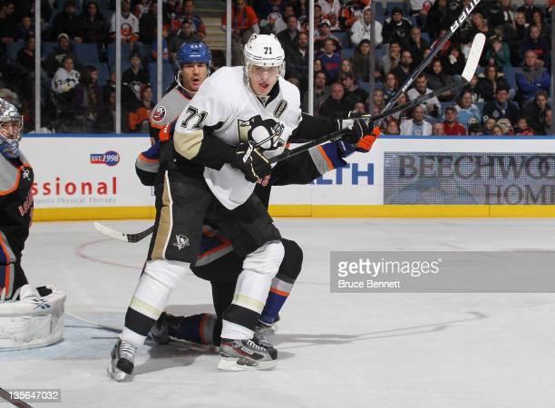 Evgeni Malkin of the Pittsburgh Penguin skates against the New York Islanders at the Nassau Veterans Memorial Coliseum on December 10 2011 in...
