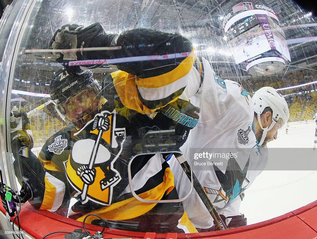 Evgeni Malkin #71 of the Pittsburgh Penguins and Dainius Zubrus #9 of the San Jose Sharks battle along the boards during the third period in Game One of the 2016 NHL Stanley Cup Final at Consol Energy Center on May 30, 2016 in Pittsburgh, Pennsylvania.