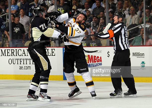 Evgeni Malkin of the Pittsburgh Penguins and Patrice Bergeron of the Boston Bruins fight towards the end of the second period during Game One of the...